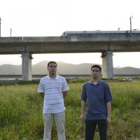 Chinese nightmare: Leo (left) and Henry Cao are seen Aug. 14 at the site where a high-speed train crashed near Wenzhou on July 23, 2011. Both of their parents were killed and Henry was seriously injured. | AFP-JIJI