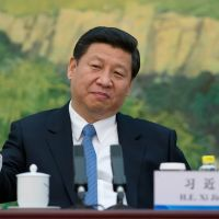 Common touch: China's new leader, Xi Jinping, attends a meeting with 'foreign experts' in Beijing on Wednesday. | AFP-JIJI