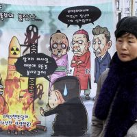 Rocket man: A cartoon caricaturing North Korean leader Kim Jong Un's rocket launch plans is displayed on a Seoul street on Sunday. | THE WORDS AT TOP LEFT READ: 