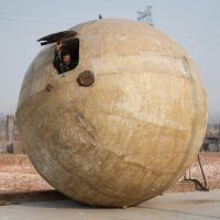 Sphere of fear: Chinese farmer Liu Qiyuan looks out from a 'tsunami-proof' survival pod he built and dubbed 'Noah's Ark,' in the Heibei Province village of Qiantun on Tuesday. | AFP-JIJI