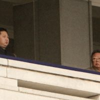 Fortunate son: The late North Korean leader Kim Jong Il (right) and his son Kim Jong Un watch a military parade commemorating the 65th anniversary of the founding of the Korean Workers' Party in Pyongyang in October 2010. | BLOOMBERG