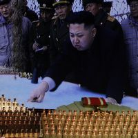 Larger than life: A photograph of North Korean leader Kim Jong Un is displayed on a giant screen during a concert on the eve of the 80th anniversary of the founding of the country's army in Pyongyang in April. | AP