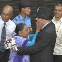 Free at last: Govinda Prasad Mainali (front right) is greeted by his mother Chandra Kala Mainali upon his arrival at the airport in Katmandu, Nepal, on June 16, 2012. | AP