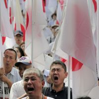Mouthing off: Japanese demonstrators rally on Sept. 22 against China's territorial claim over the disputed islands, called Senkaku in Japan and Diaoyu in China. | AP