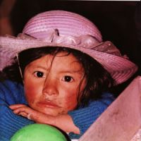 Impoverished: A young girl from the San Martin region of the Peruvian Sierra gazes into the camera in this photo taken in 1999. Mario Vargas Llosa says that in his childhood, Peru was poor and backward, but it had become 'poorer still and in many regions poverty-stricken, a country that was going back to inhuman patterns of existence.' | KEVIN RAFFERTY