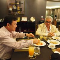 Top table: Tom Plate (right) dines with Thaksin Shinawatra at the former Thai prime minister's Dubai residence. | COURTESY OF THE DUBAI HOUSEHOLD OF THAKSIN SHINAWATRA