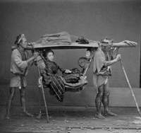 Many of the early photographs of Japan, such as the one above of a woman in a  kago  (palanquin) taken in the 1870s in the Yokohama studio of a photographer named Yamamoto (first name unknown), were intended for export in souvenir albums sold to foreigners. Below: The cover of Bennett's book features sumo wrestlers photographed ca. 1872 by Baron Raimund von Stillfried-Ratenicz, an Austrian who operated a studio in Yokohama. | COURTESY OF TERRY BENNETT