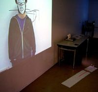 Self refelctive: The installation by Taro Izumi shows a video of the artist creating a work that can be found on the opposite wall of the same room. | DONALD EUBANK