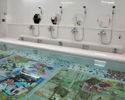 Water colors: A collage of images can be seen under the bath water in the 'I Love Yu' bathhouse in Naoshima, Kagawa Prefecture.