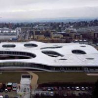 Four walls: The billowing Rolex Learning Center in Lausanne, Switzerland (aboce), and the sublime Christian Dior Building in Tokyo's Omotesando district (below) are prime examples of the SANAA architecture agency's approach to 'buildings that are bigger than their site.' | HISAO SUZUKI