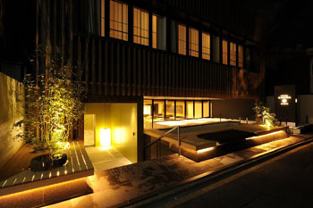 From top: The Hotel Kanro facade, a view of a suite, and a Superior Tatami room. | COURTESY OF KANRA HOTEL