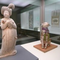 It's a dog's life: 'Chinese Court Lady Holding a Pekinese' (Tang Dynasty, eighth century), and 'Dog-shaped Saga Doll' (Edo Period, 17th century). | KYOTO NATIONAL MUSEUM/SACHIKO TAMASHIGE PHOTOS
