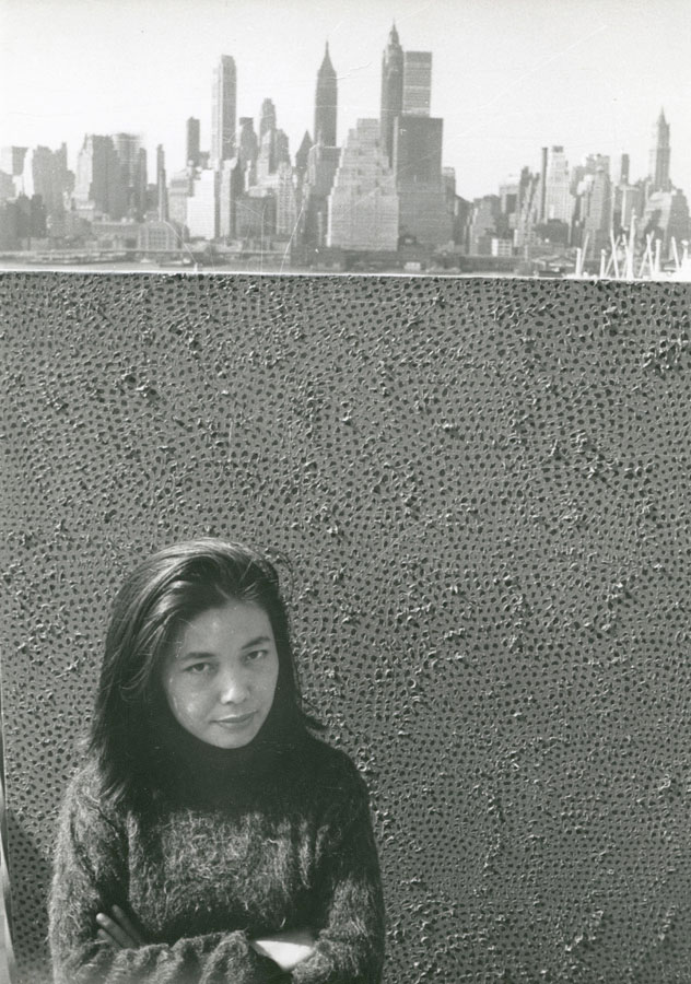 'Yayoi Kusama with her work, against a background of Manhattan, NY. 1961.' | (C) YAYOI KUSAMA