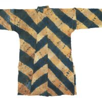 Pattern recognition: A tie-dyed jacket decorated with bold diagonal blue and red stripes that was worn by officials of the Todaiji construction bureau in the Nara Period (710 - 784). | NARA NATIONAL MUSIUM / SHOSOIN