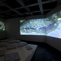 Virtual walk: On the  fourth floor of the Watari Museum of Contemporary Art, visitors can relax while viewing Mirei Shigemori's representative gardens in a large-scale film projection. | WATARI MUSEUM OF CONTEMPORARY ART