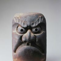 Face of Tohoku: This wooden mask  (19th century), would have been hung on the kitchen pillar of a newly built Tohoku home as a talisman to ward off evil spirits | JAPAN FOLK CRAFTS MUSEUM