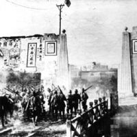 Selective memory: Japanese Imperial Army soldiers enter Nanking in 1937. Some Japanese politicans deny the Nanking massacre ever took place. John W. Dower asserts that victim consciousness remains a major impediment to a full and forthright reckoning in Japan and other countries about their wartime past.