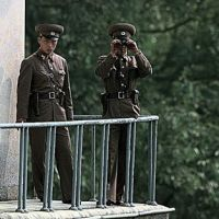 Quintessential police state: North Korean border guards stand watch over the Demilitarized zone, which separat