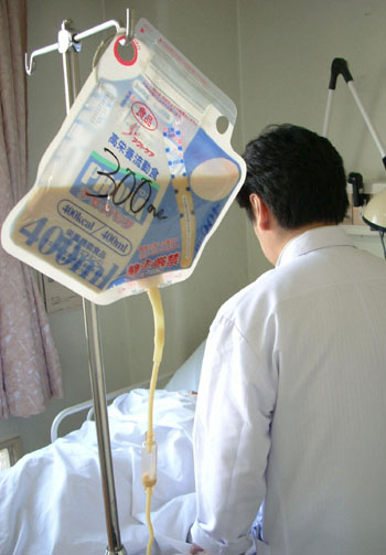 Food for thought: The high cost of feeding tubes and other medical treatments is eating away at the Japanese health-care system.   KYODO PHOTO