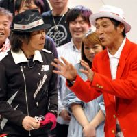 Comic mojo: Sanma Akashiya (right) celebrates fellow comedian Kanpei Hazama's  completion of a round-the-world marathon earlier this year. | KYODO PHOTO