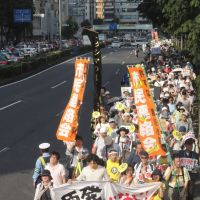 Unheard voices: The Sept. 19 march in Tokyo against nuclear power was the largest demonstration since the 1960s, yet most television and newspaper coverage chose to focus on the festivallike atmosphere of some parts of the event rather than the political issue itself. | KAZUAKI NAGATA PHOTOS