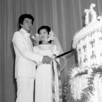 Silent partners: Tomokazu Miura (left) and Momoe Yamaguchi cutting the cake on their wedding day in 1980. Yamaguchi, the most popular idol singer of the 1970s, retired from show business to marry Miura and has been out of the public eye ever since. | KYODO