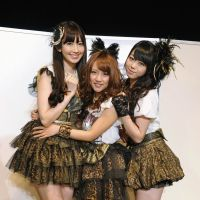 Caught in the middle: Minami Takahashi (center) poses with fellow members of the AKB48 spinoff group No Sleeves, Haruna Kojima (left) and Minami Minegishi (right). Takahashi's mother was recently fined for having sex with a 15-year-old boy.