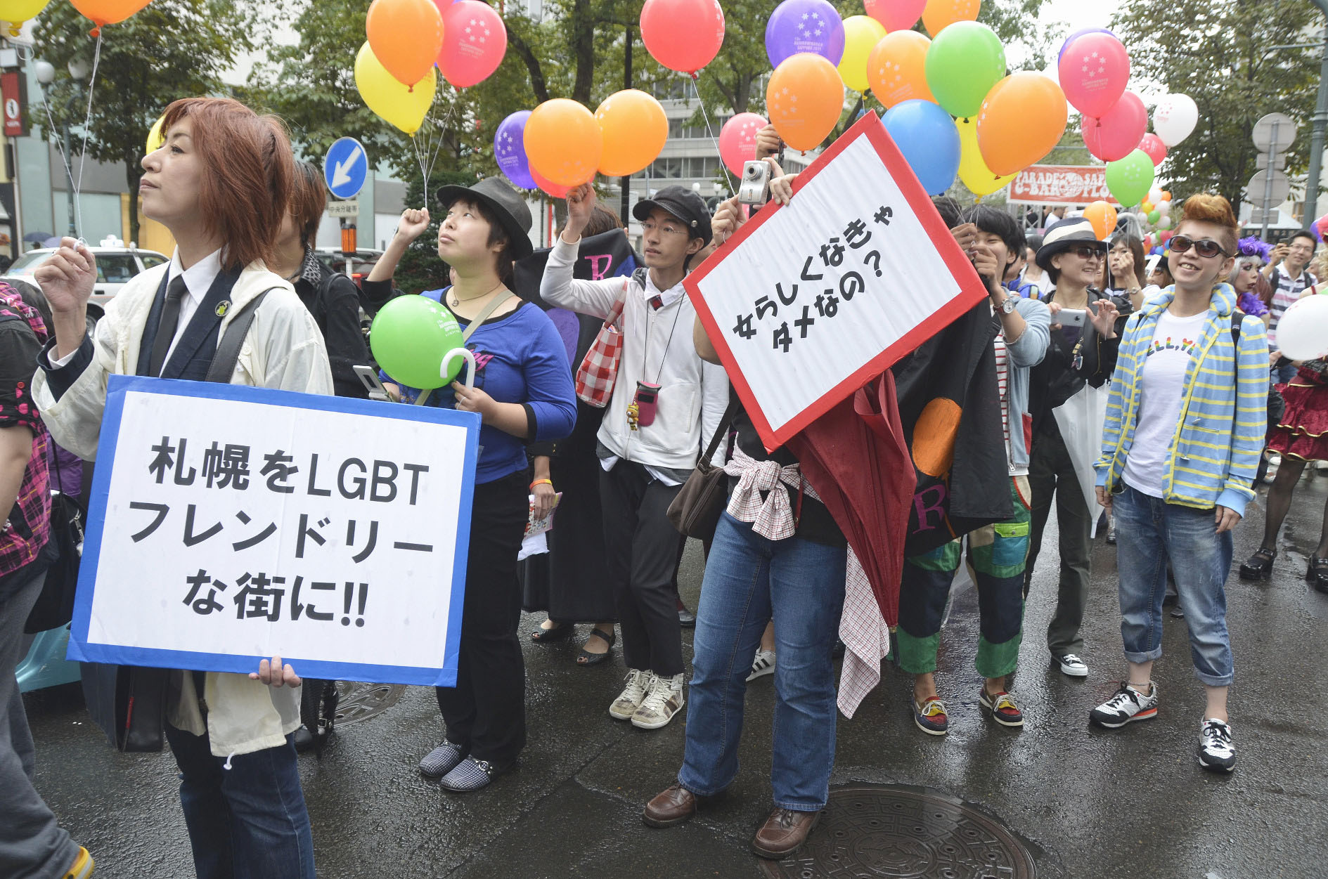 Proud to be LGBT: Participants take part in the 15th Rainbow March in Sapporo, Hokkaido on Sept. 18, 2011. Though LGBT people are represented on Japanese TV, their gender roles are usually of a clearly stereotypical nature. | KYODO