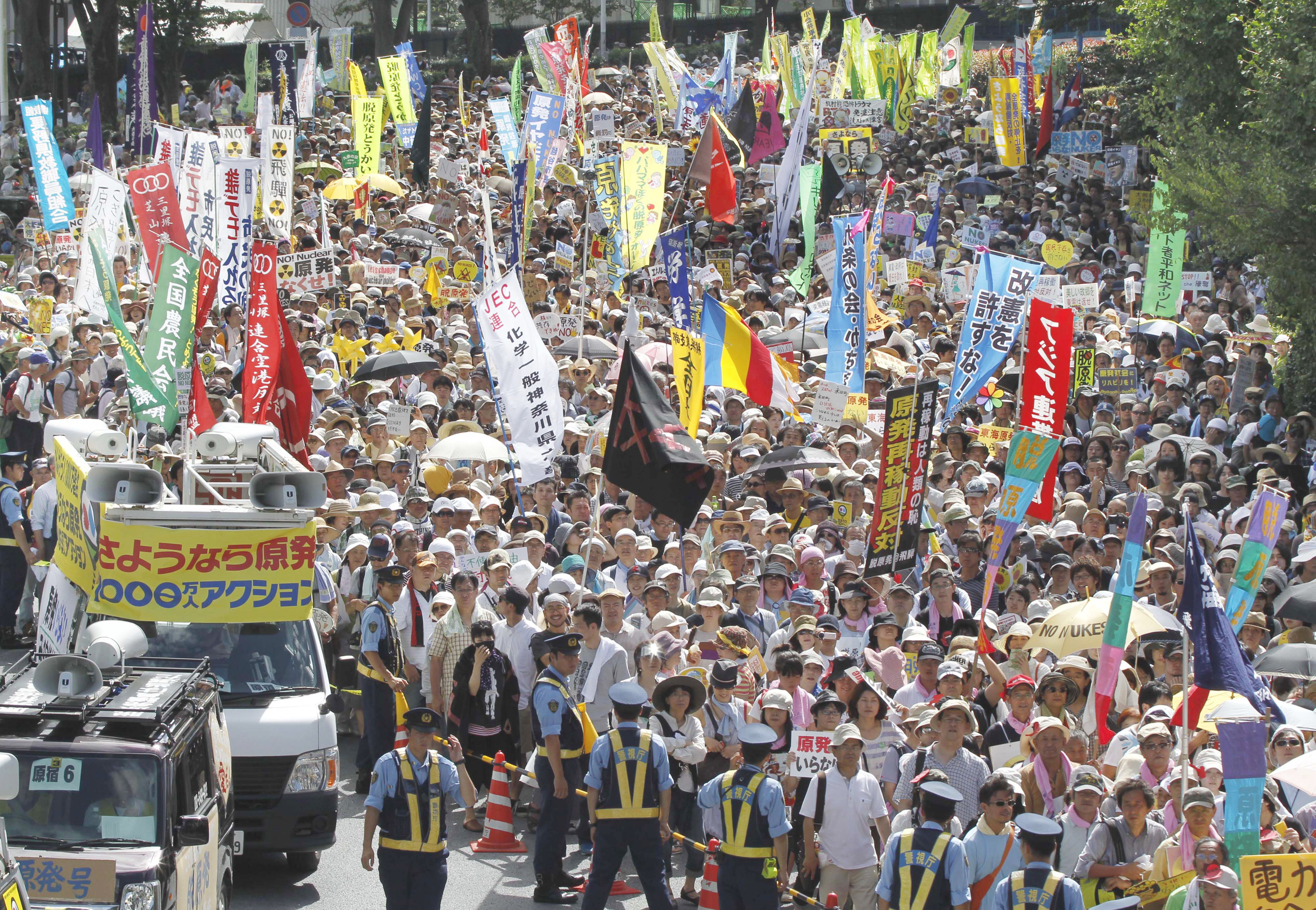 Count us in: As more and more people turn out for antinuclear rallies, inconsistencies in the estimated number of protesters have become a concern. At this event in Tokyo on July 16 the figure ranged from 75,000 to 170,000. | AP