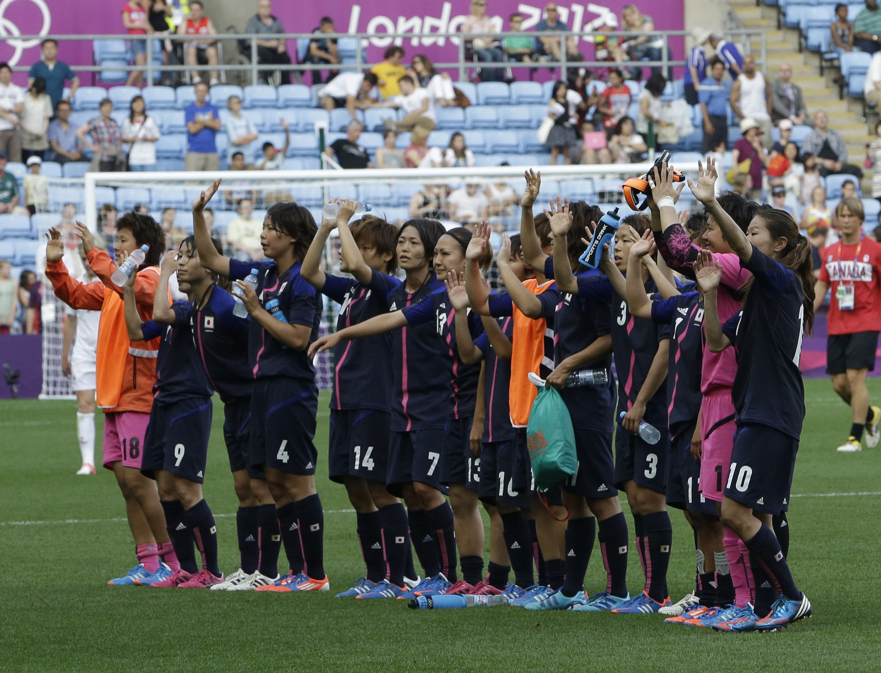 Upgrade deserved: The Japanese women's soccer team acknowledge their fans after defeating Canada in their first match at the London 2012 Olympics, July 25, 2012. | AP