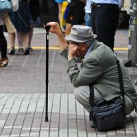 New life: A senior citizen in Tokyo takes a break. A recent government report suggests that companies hire graduates on 10- or 20-year contracts, which it says would allow people to start new careers when they reach their 60s. | SOFIA ELGHAZZALI