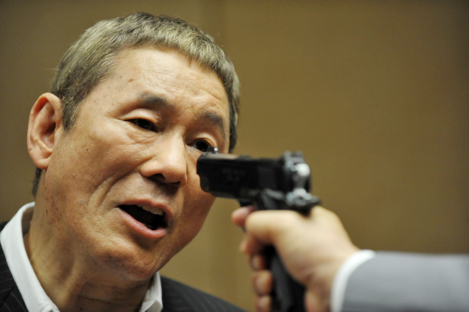 Make believe: Takeshi Kitano in a still from his latest film 'Outrage Beyond' (2012). Kitano often uses violence in his films and has admitted that the basis of his humor is bullying, but everyone understands it's all in fun. | KYODO