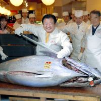 Fishy business: Kiyoshi Kimura (center), president of Sushi Zanmai, told Nikkan Gendai, 'Actually, I never thought it would reach that price. Honestly, I was surprised, but we decided to buy with the thought of wanting  this year as well  to serve our customers the best tuna, so all we could do was keep bidding.' | KYODO