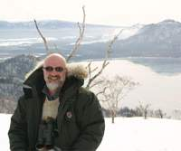 Yours truly with much-loved Genesis bins a-dangling darkly during a field trip to Kussharo-ko Lake in Hokkaido.