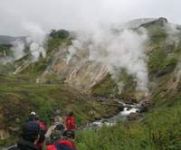 The beautiful scene that used to confront nature tourists like these (above); the so-called Lesser Geyser's last eruption before it was swamped; and an aerial shot of the massive landslip and floodwaters backing up along the valley. | MARK BRAZIL PHOTO (above); PHOTOS COURTESY OF FILATKINA / WWF
