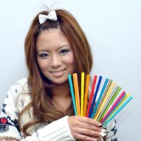 Hip young businesswoman Shiho Fujita  proudly shows off her collection of my-hashi chopsticks. | YOSHIAKI MIURA PHOTO
