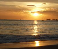 Beguiling idyll: Sunset over a beach on the Pacific coast of Costa Rica, where for years uncountable sea turtles have come to lay their eggs — but where tourist developments and rapacious offshore fisheries now threaten the remarkable reptiles' future. | ROWAN HOOPER PHOTOS