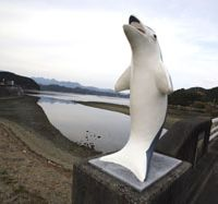 Sick symbol: A dolphin monument on the road in to the town of Taiji, Wakayama Prefecture, which strives to enrich its inhabitants by trumpeting the wonders of this species, while locals trap and spear thousands each year in the local coves. | AP PHOTO