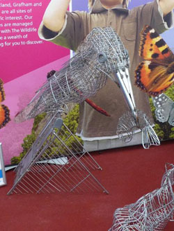 Making a point: One of many art works at BBWF, this kingfisher with a fish was made from dumped shopping carts recovered from waterways that are the bird's habitat. | MARK BRAZIL PHOTOS