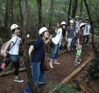Positive thinking: Chuo University students from the teacher-inspiring seminar referred to in this column head off to visit a bat cave near Mount Fuji. | STEPHEN HESSE