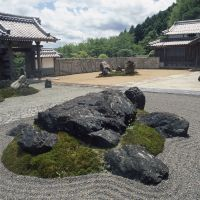 Rock on: A tortoise arrangement sits in the northern portion of the garden, while in the west section, a tiger shape erupts out of the white gravel.
