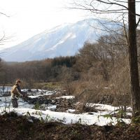 The joys of nature: An old gent casts a line into the Torii River, with Kurohime mountain as a magnificent backdrop. For safety's sake, perhaps he too should be banned from playing by the river as our local elementary school children now are.