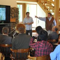 Water course: Canada-based rivers expert Don McCubbing gives a talk at our Afan Centre (above); a Coho salmon (above left) back to spawn in the Keogh River on Vancouver Island, where McCubbing sites obstructions (right) to create back eddies and pools. | SIMON WEARNE (ABOVE); DON MCCUBBING