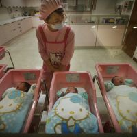 Hello kiddy: Japan's fertility rate has dropped to fewer than two children per woman, which will result in a significantly lower and older population. New advances in science, however, could make it possible to grow a baby in an artificial womb, outside of the human body. | AP