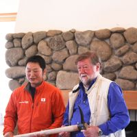 Horse-logger Takashi Iwama  presents Old Nic with a logging tool embossed with 'Aka Oni,' meaning 'Red Devil,' on the handle.