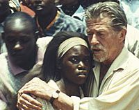 Clare-Hope Ashitey and John Hurt in 'Shooting Dogs' | (c)BBC, UK FILM COUNCIL AND EGOLI TOSSELL 2005