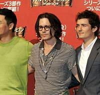 Chow Yun-Fat, Johnny Depp and Orlando Bloom at a news conference in Tokyo on May 23 | AP PHOTO