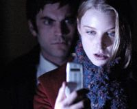 Nosey parker: Wes Bentley creeps up on Rachel Nichols to read her text messages in 'P2'