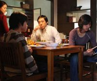 Kyoko Koizumi, Kai Inowaka, Teruyuki Kagawa and Haruki Igawa in a scene from Kiyoshi Kurosawa's 'Tokyo Sonata.'