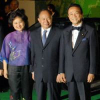 Red carpet: John Woo is joined by his wife Annie and Japanese Prime Minister Taro Aso for the film's Tokyo opening on Oct. 25.